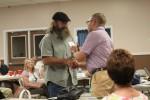Randall Conner accepts his badge